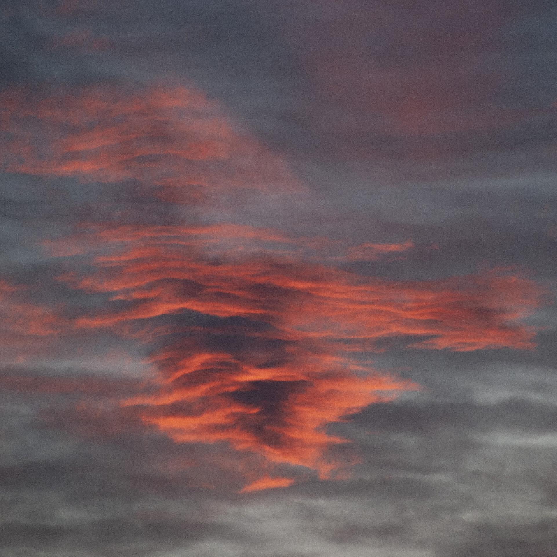 a beautiful orange cloud in a stormy sky